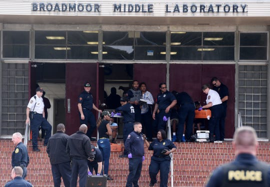 Students are removed from Broadmoor Middle Labratory Tuesday afternoon as at least 17 units responded to a Hazardous Material call.
