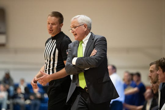 Gary Garner talks with an official during a recent game at Dakota State in Madison.