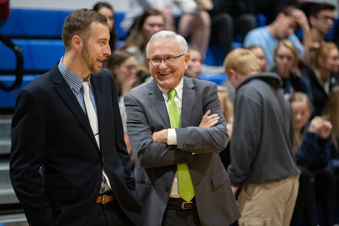 Dakota State men's basketball coach Gary Garner (right) was diagnosed with pancreatic cancer in 2017.