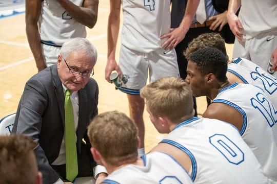Dakota State coach Gary Garner addresses his team during a game in Madison.