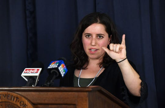 Media witness Arielle Zionts from the Rapid City Journal shows the hand gesture Charles Rhines made during his execution on Monday, November 4, at the South Dakota State Penitentiary in Sioux Falls.