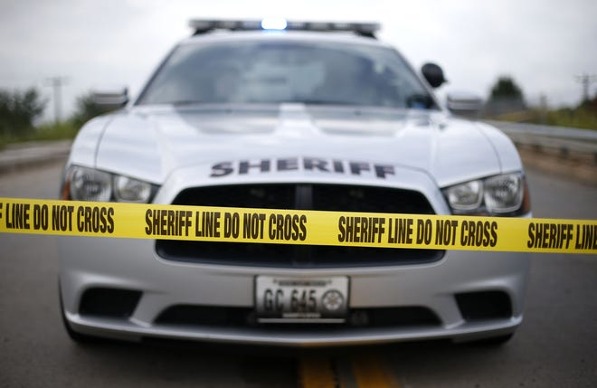 A News-Leader file photo shows a Greene County Sheriff's Office vehicle behind crime scene tape.