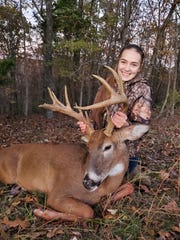 Aubrey Sorrell, 15, shows the 13-point buck she shot Saturday with a 7 mm Remington magnum rifle. She shot her first deer last year with the same gun.
