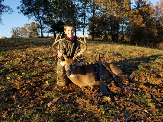 Levi Sorrell, 13, with the 7-point buck he shot Sunday during the weekend youth hunt.