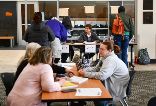 Election workers talk with voters during the Sauk Rapids-Rice school district referendum vote Tuesday, Nov. 5, 2019, at the Sauk Rapids Government Center.
