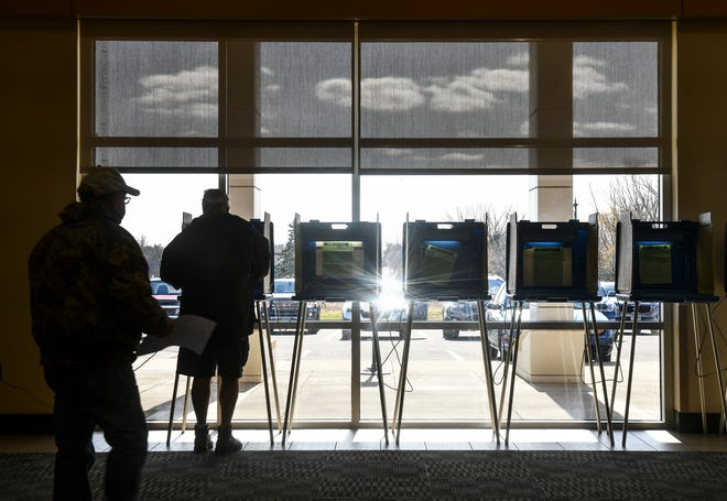 Voters cast their ballots in the Sauk Rapids-Rice school district referendum Tuesday, Nov. 5, 2019, at the Sauk Rapids Government Center.