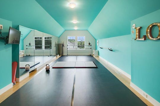 A complete dance studio with wall-to-wall mirrors and a workout floor is available on the second level.