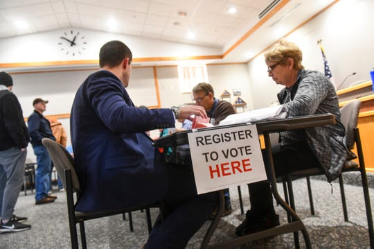 Voters are registered and checked in during voting for the Sartell-St. Stephen school district referendum Tuesday, Nov. 5, 2019, at Sartell City Hall.