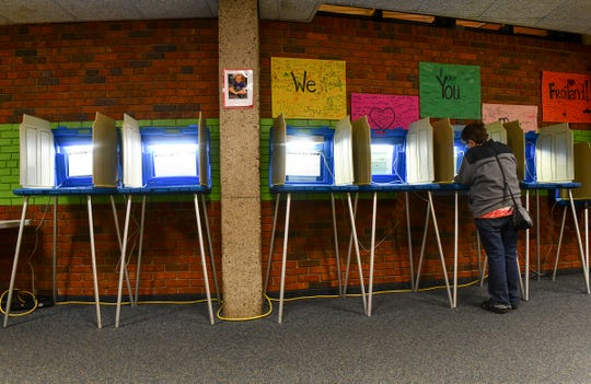 A voter casts a ballot  in the Sauk Rapids-Rice school district referendum Tuesday, Nov. 5, 2019, Pleasantview Elementary School in Sauk Rapids.