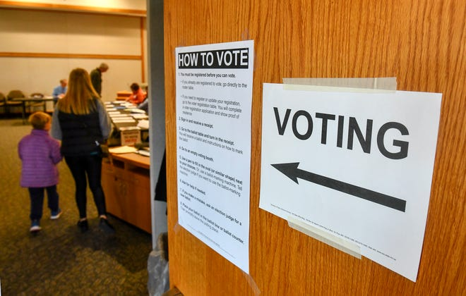 Voters make their way to the polls for the Sartell-St. Stephen school district referendum Tuesday, Nov. 5, 2019, at Sartell City Hall.