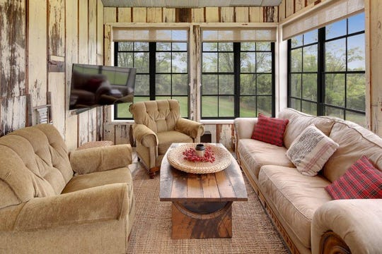A screen room provides a space for relaxing with complete views of the neighborhood and its open spaces.