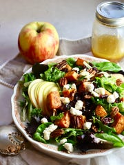 Fall Harvest Salad is full of roasted sweet potatoes, juicy sliced apples, and crunchy roasted pecans.