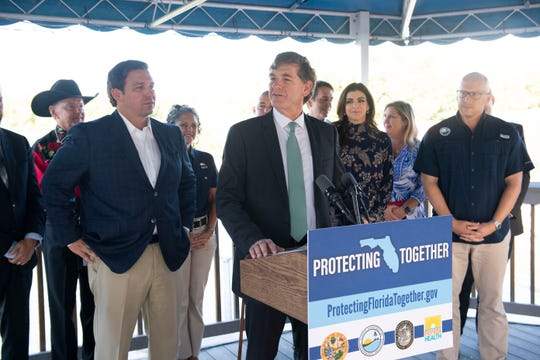 Florida Surgeon General Dr. Scott Rivkees speaks at a news conference where Gov. Ron DeSantis announced a new website that features information on South Florida water conditions on Tuesday, Nov. 5, 2019, at the Florida Oceanographic Society's Coastal Center on Hutchinson Island in Stuart.
