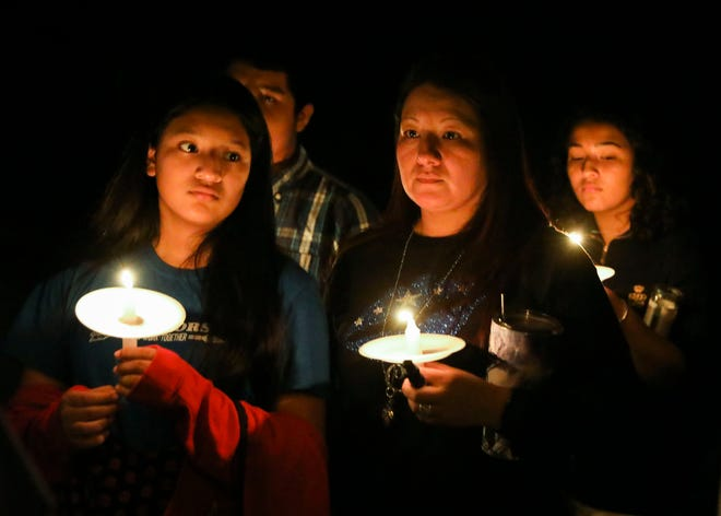 "Family and friends gather for a candlelight vigil in remembrance of Jimarion ""Jay"" Jones, 14, at Southwest 172nd Avenue on Monday, Nov. 4, 2019, in Indiantown. Jones was shot and killed Sunday night by a 17-year-old friend inside the friend's home in Indiantown. The 17-year-old was arrested on one charge of aggravated manslaughter of a child Sunday. The boy told Martin County Sheriff's office deputies he was ""dancing with"" a handgun when his finger slipped and he accidentally shot Jones in the stomach. Jones was a student at Indiantown Middle School."