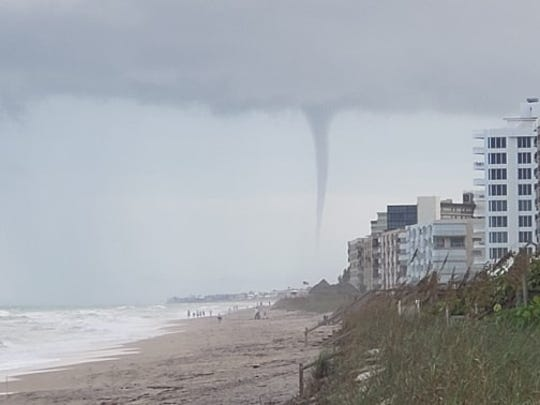 A waterspout over Stuart Beach was photographed from Nettles Island on Tuesday, Nov. 5, 2019. A brief tornado warning was issued until 4:30 p.m.