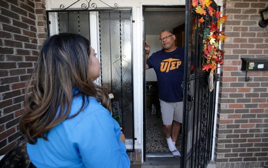 District 3 city Rep. Cassandra Hernandez talks with Stephen Thomas as she goes door to door on Election Day on Tuesday, Nov. 5, 2019.