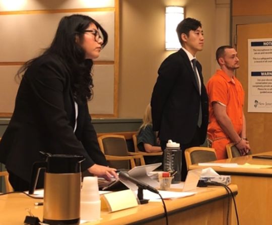 Millville resident Sean P. Beeman (right) appears Monday at his arraignment in Cumberland County Superior Court. Beeman is charged with theft for allegedly taking a camera from inside a Millville police cruiser. He is represented by state Deputy Public Defender Andrew Moon (center). Assistant Prosecutor Angelica Carrasco (left) represents the state.