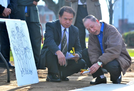 Hmong shamanist Khoua Lee Moua, right, and veteran Xeng Xiong burn incense in a traditional blessing the ground in November during the Hmong Vietnam War Veterans Memorial groundbreaking ceremony at the Marathon County Courthouse in Wausau.