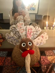 Turkey On The Table:  Suffern's Judy Klein picked up this idea from two moms who wanted to teach their children gratitude. The concept is, write what you are thankful for on a cardboard tail feather and insert it into a clip on the tail end of the turkey.