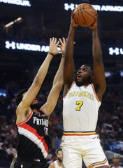 Golden State Warriors forward Eric Paschall (7) shoots over Portland Trail Blazers forward Skal Labissiere during the first half of an NBA basketball game in San Francisco, Monday, Nov. 4, 2019. (AP Photo/Jeff Chiu)