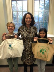 Town of Mamaroneck Supervisor Nancy Seligson with students Nola (left), formerly of the Mamaroneck Avenue School and Juliette, of the St. John's and Paul School. Both students won the town's reusable bag design contest.