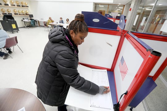 Michelle Atterberry fills out her ballot at Mount Vernon High School Nov. 05, 2019. Three candidates are vying for Mayor in Mount Vernon.