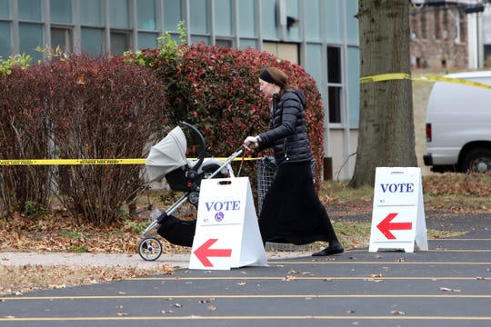 A voter arrives at Ramapo High School to cast her ballot on Election Day Nov. 5, 2019 in Spring Valley.