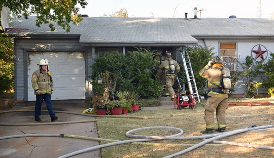 Wichita Falls firefighters work the scene of a housefire Monday afternoon on Star Vista Drive. Five family pets died inside the home, but no other injuries were reported.