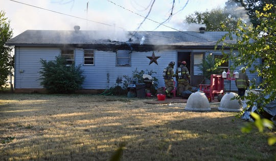 Wichita Falls firefighters enter a house in the 1600 block of Star Vista Drive Monday afternoon. No one was home at the time of the fire, but two dogs and three cats died inside the home.