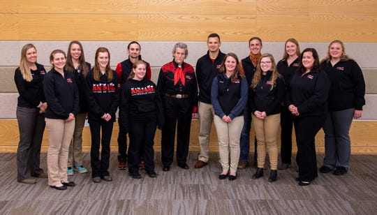 Temple Grandin, center, designer of livestock-handling facilities and professor of animal science at Colorado State University, is joined by UW-River Falls professors Brian Greco and Kurt Vogel along with students in the Animal Welfare Lab.