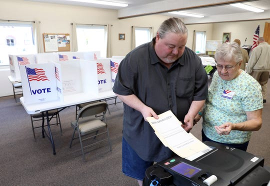 DJ Dittmar casts his ballot at Central Trinity United Methodist Church in Zanesville on Tuesday.