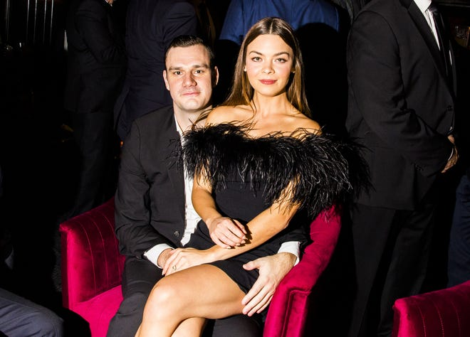 Cooper Hefner and Scarlett Byrne sit for a photo in the Playboy Club in New York on Sept. 12, 2018.