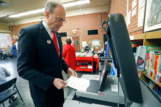"Republican candidate for lieutenant governor and current Secretary of State Delbert Hosemann electronically ""casts"" his ballot after voting in Jackson, Mississippi on Nov. 5, 2019."