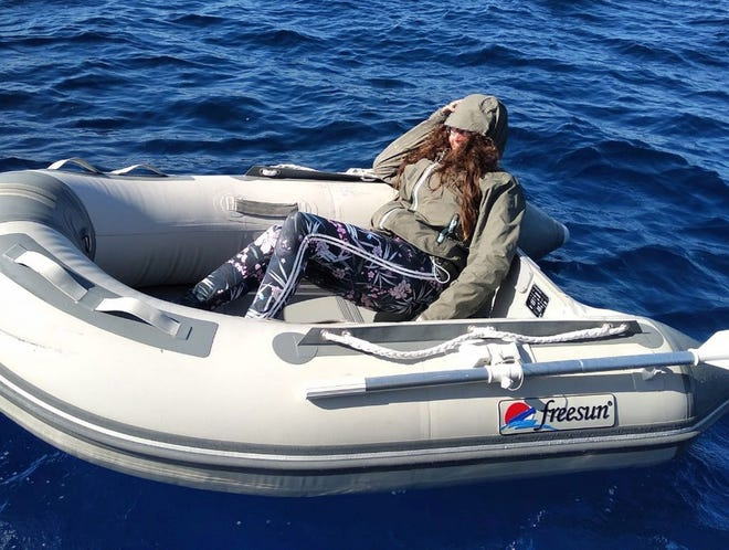 A handout photo made available by the Hellenic Coast Guard shows Kushila Stein from New Zealand in her rubber dinghy after being rescued by the Hellenic Coast Guard, north of Crete Island, Greece.
