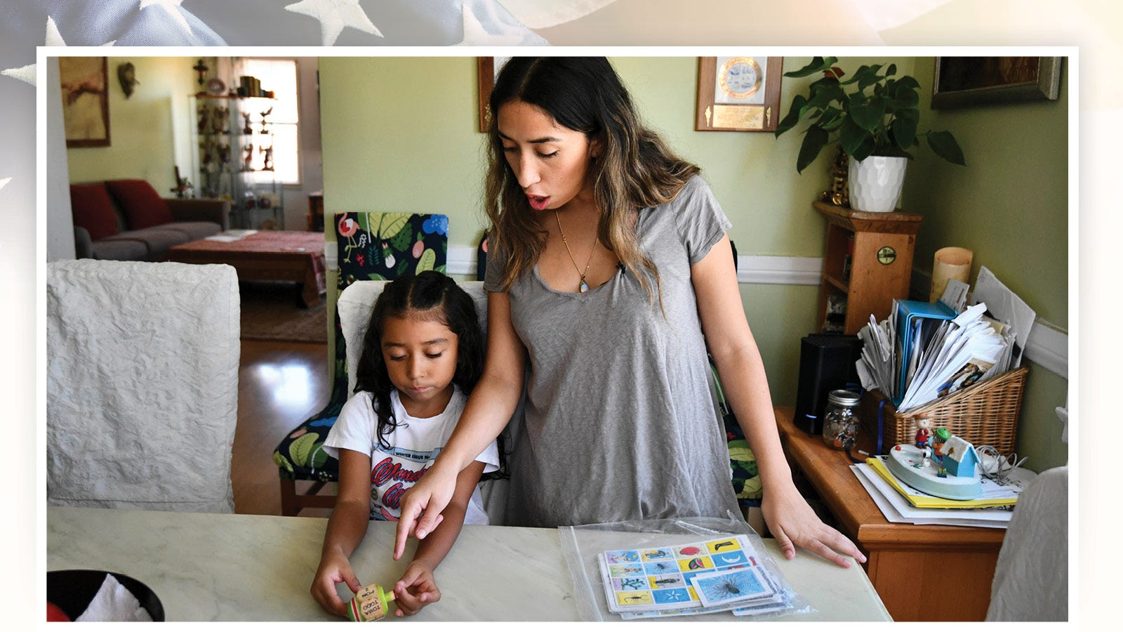 Linda Ortiz and her daughter, Sophie, prepare to play Lotería, a popular Spanish game. Sophie is part of a bilingual education class at UCLA Lab School, where she is learning 90% Spanish and 10% English.