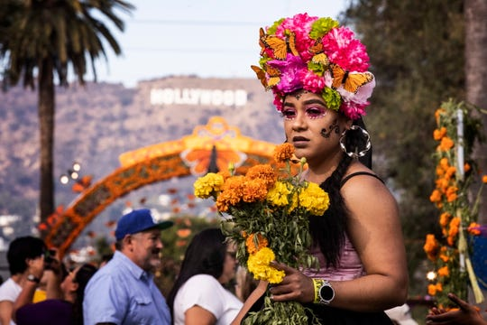 A woman in costume attends the Day of the Dead celebration at the Hollywood Forever Cemetery