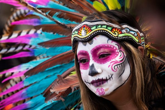 A visitor wearing costume attends the Day of the Dead celebration at the Hollywood Forever Cemetery