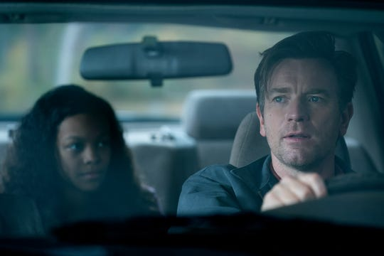 "A grown-up Dan Torrance (Ewan McGregor) helps fellow psychic Abra Stone (Kyliegh Curran) in ""The Shining"" follow-up ""Doctor Sleep."""