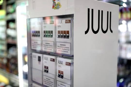 Juul products are displayed at Smoke and Gift Shop on October 17, 2019 in San Francisco, California. Juul announced plans to immediately suspend sales of its  fruit flavored e-cigarettes ahead of a policy by the Trump administration that is expected to ban all flavored e-cigarettes.