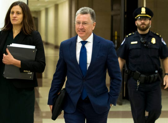 FILE - In this Oct. 3, 2019 file photo, Kurt Volker, a former special envoy to Ukraine, is leaving after a closed-door interview with House investigators, at the Capitol in Washington.  House investigators are releasing more transcripts Tuesday in the impeachment inquiry of President Donald Trump with hundreds of pages of testimony from two top diplomats dealing with Ukraine. Kurt Volker, the former special envoy to Ukraine, and Gordan Sondland, the U.S. Ambassador to the European Union, both testified about Trump's interest in pursuing investigations of Joe Biden and Democrats as the White House withheld military aide to the East European ally. (AP Photo/Jose Luis Magana) ORG XMIT: WX101