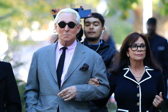 Roger Stone, left, with his wife Nydia Stone, arrives at the federal court in Washington on Nov. 5, 2019. Stone, a longtime Republican provocateur and former confidant of President Donald Trump, goes on trial over charges related to his alleged efforts to exploit the Russian-hacked Hillary Clinton emails for political gain.