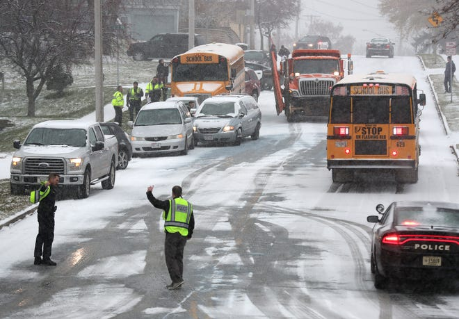 Police on the scene of a crash, several vehicles including a school bus, on Boyd Ave. Wednesday, Nov. 6, 2019, in Kaukauna, Wis. A second bus, lower right, was dispatched to transport students from the scene. A city plow was also on scene to salt the steep hill.