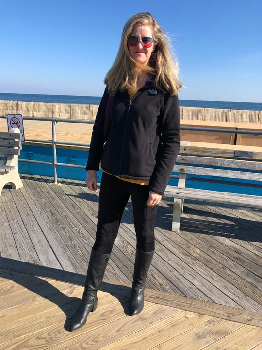Beth Trigini, 50,  walks along the Asbury Park Boardwalk in her favorite fall clothing item.