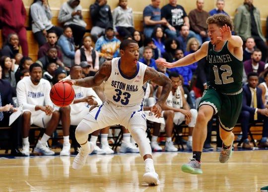 Seton Hall guard Shavar Reynolds (33) drives to the basket against Wagner guard Chase Freeman (12)