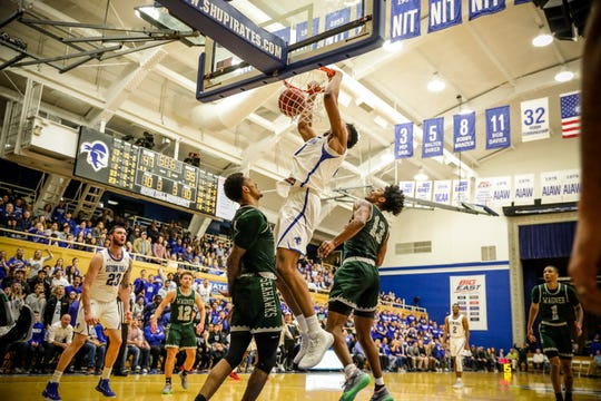 Seton Hall center Ike Obiagu throws down a dunk against Wagner at Walsh Gym.