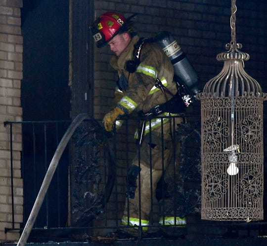 An Abilene firefighter works during a fire at the Maison Blanche apartments Wednesday.