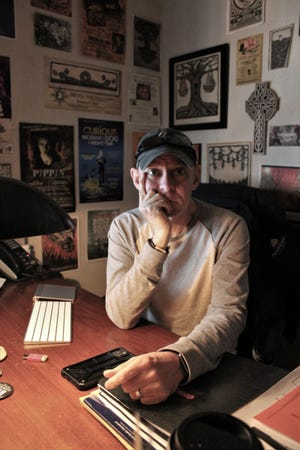 Barry Smoot, in the second-floor office at the Paramount Theatre that he keeps dark and full of memorabilia. He has been at downtown theater since 1991 but was absent for two months in late 2018 after congestive heart failure.
