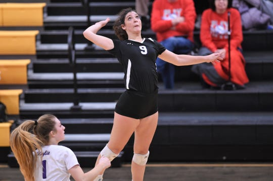 Wylie's Keetyn Davis (9) goes up for a kill against Lubbock Monterey during the Region I-5A bi-district playoff at Snyder on Tuesday, Nov. 5, 2019. The Lady Bulldogs won 3-0 for their first-ever Class 5A playoff victory.