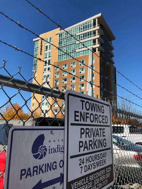 The Hotel Indigo downtown contracts to lease 20 parking spaces in a city of Asheville surface lot on O. Henry Avenue. The total monthly cost is $1,400, or $70 per parking space.