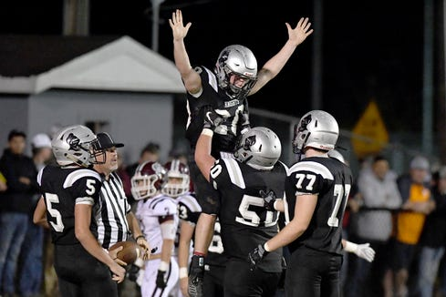 Robbinsville's Lex Hooper gets lifted up by his teammate Candler Edwards after scoring a touchdown against Swain County during their game in Robbinsville on Oct. 28, 2019.